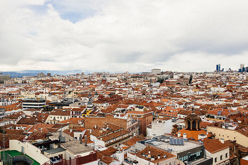 Beautiful Madrid city scene with beautiful cloudy sky, view from roof top by Kristen Curette Hines for Stocksy United