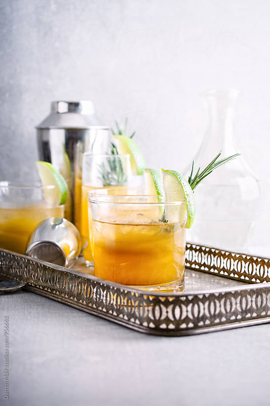 Mixed vodka and pineapple cocktails. by Darren Muir for Stocksy United