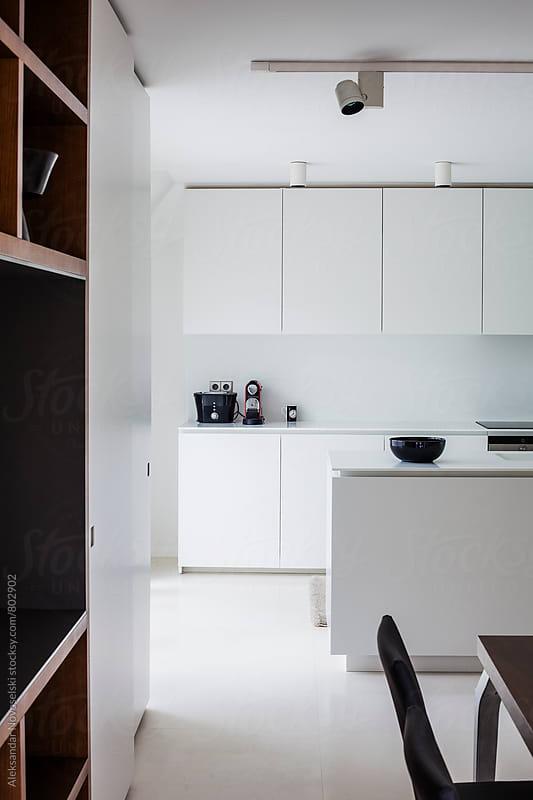Minimalist white kitchen in contemporary interior by Aleksandar Novoselski for Stocksy United