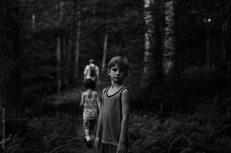 Boys hiking at night by Ali Deck for Stocksy United