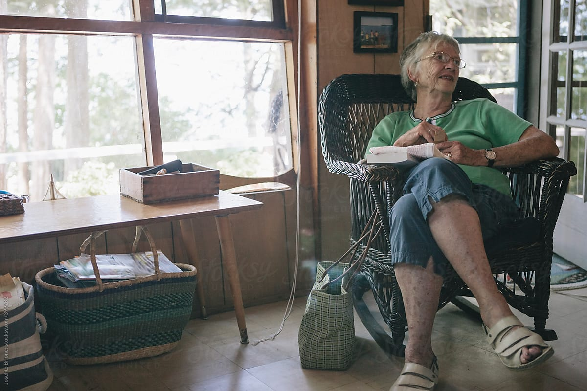 Brilliant Senior Woman Sitting On Rocking Chair With Book In Rural Onthecornerstone Fun Painted Chair Ideas Images Onthecornerstoneorg