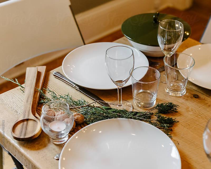 Table set for Christmas dinner by Jen Grantham for Stocksy United