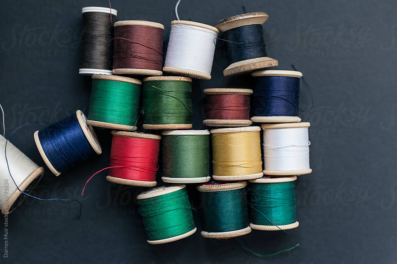 Threads of various colors.  by Darren Muir for Stocksy United