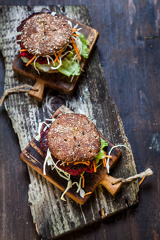 Beetroot-Burger with salad by Susan Brooks-Dammann for Stocksy United