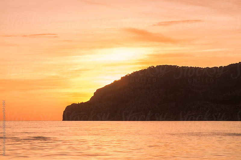 Silhouette of the Majorca coast at sunset by Marilar Irastorza for Stocksy United