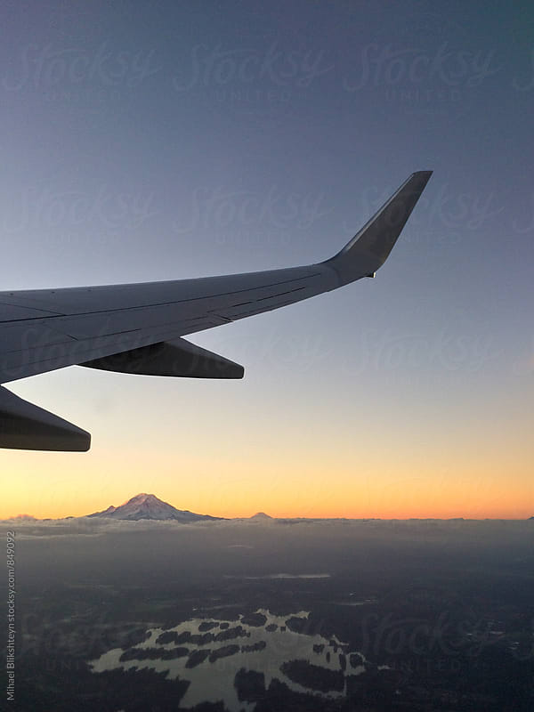 View of Mount Rainier at sunrise from the airplane by Mihael Blikshteyn for Stocksy United