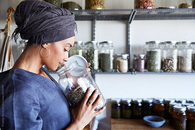 Millennial African American Woman Maker in Her Studio Smelling Ingredients by Trinette Reed for Stocksy United