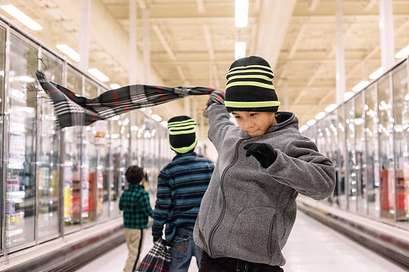 Kids playing in the supermarket by Lawrence del Mundo for Stocksy United