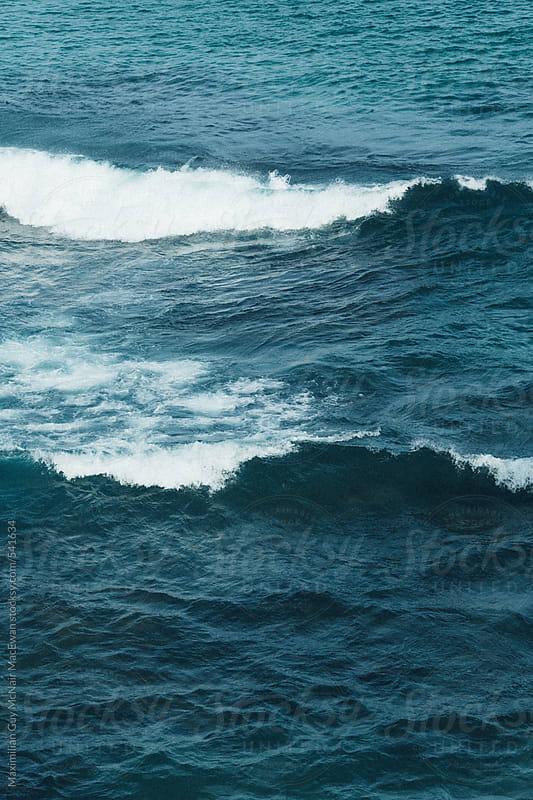 Waves break on a beautiful day by Maximilian Guy McNair MacEwan for Stocksy United