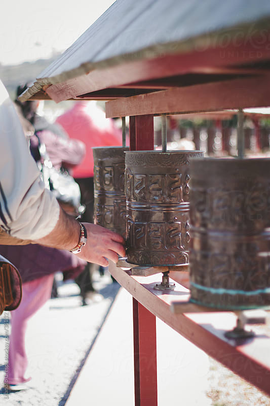 tibetan prayer wheels by Leandro Crespi for Stocksy United