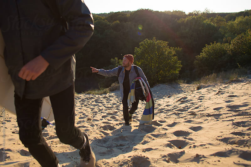 Waling up a sand dune and looking for the right way by Denni Van Huis for Stocksy United