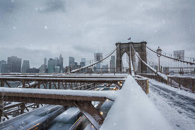 Rash hour traffic going over Brooklyn Bridge in snow, New York by yuko hirao for Stocksy United