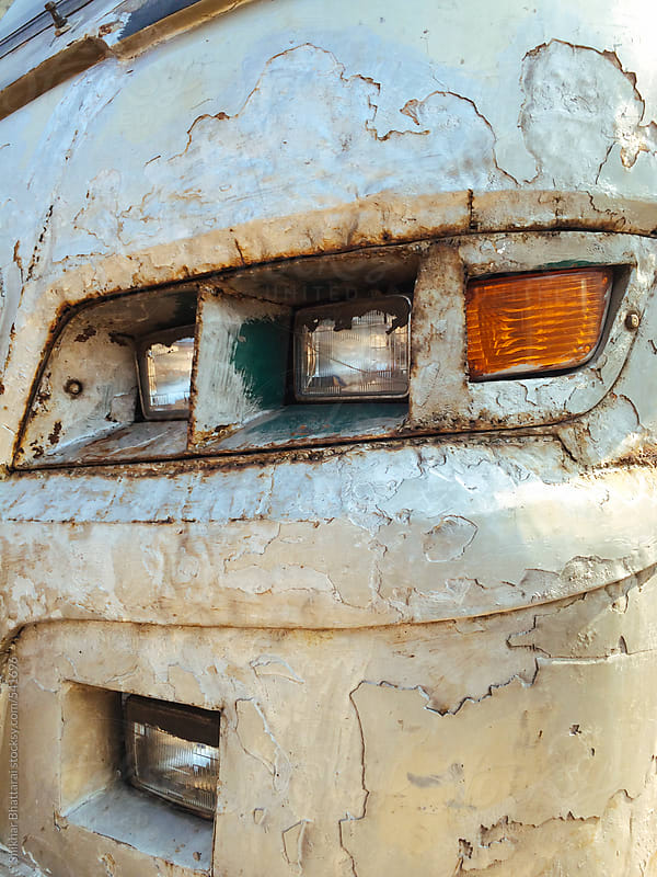 A banged up and reconstructed headlights of a bus. by Shikhar Bhattarai for Stocksy United