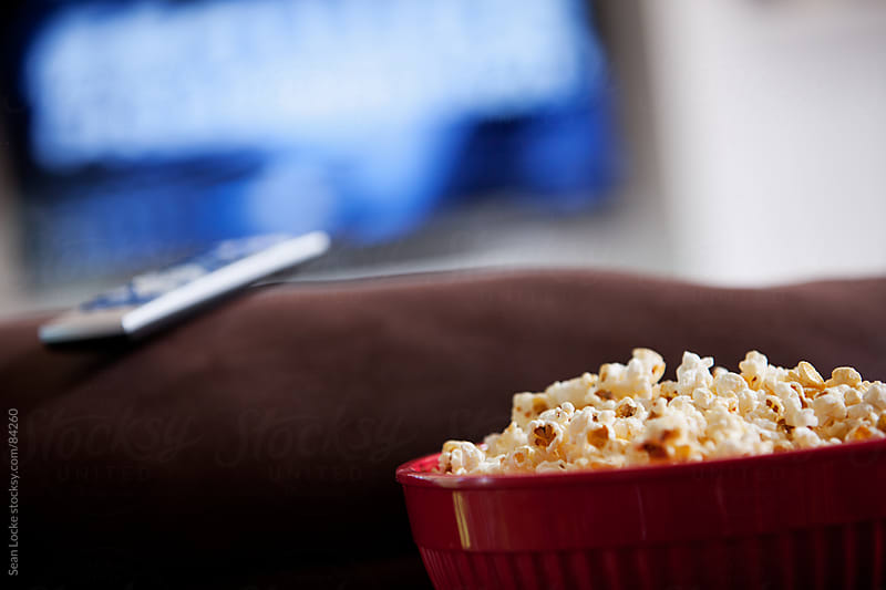 Television: Focus on Popcorn Bowl by Sean Locke for Stocksy United