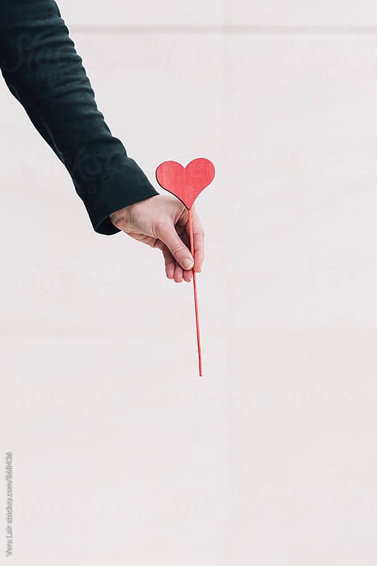 Woman hand holding a heart by Vera Lair for Stocksy United