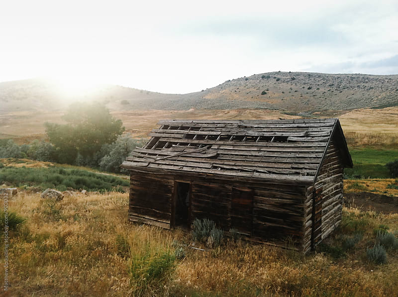 Old barn in rural Wyoming landscape at sunset by Matthew Spaulding for Stocksy United