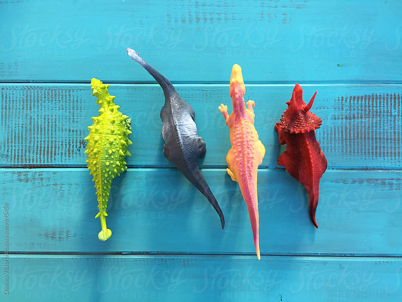 A group of toy dinosaurs by Chelsea Victoria for Stocksy United