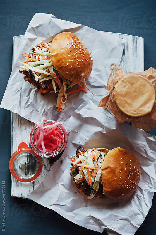 Grilled paprika chicken burger  by Ellie Baygulov for Stocksy United