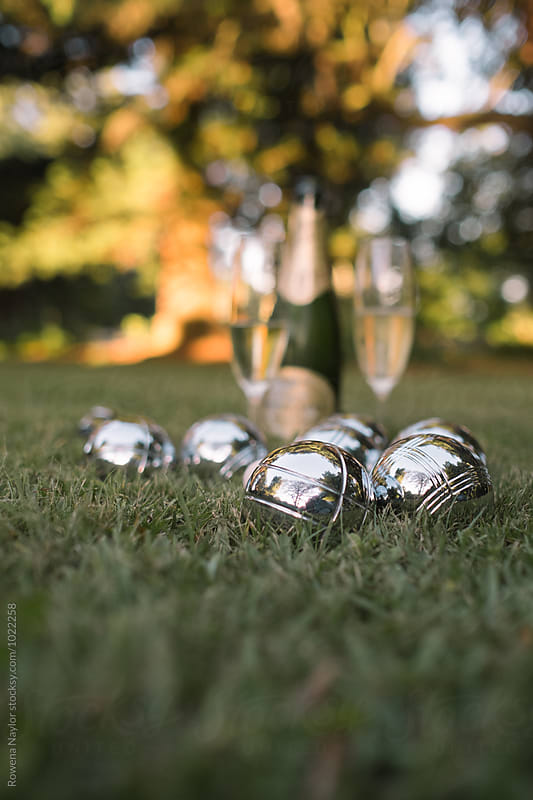 French boules and champagne on a lawn by Rowena Naylor for Stocksy United