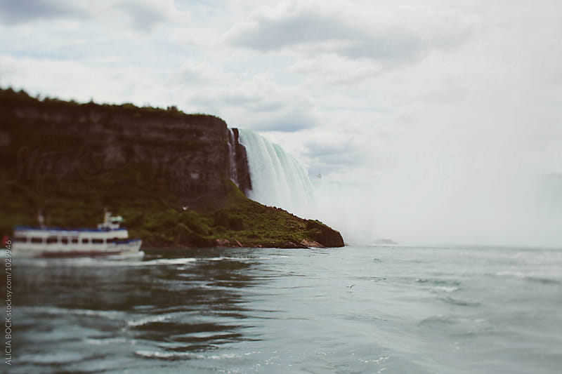 A Tourist Boat Heading Into Niagara Falls by ALICIA BOCK for Stocksy United