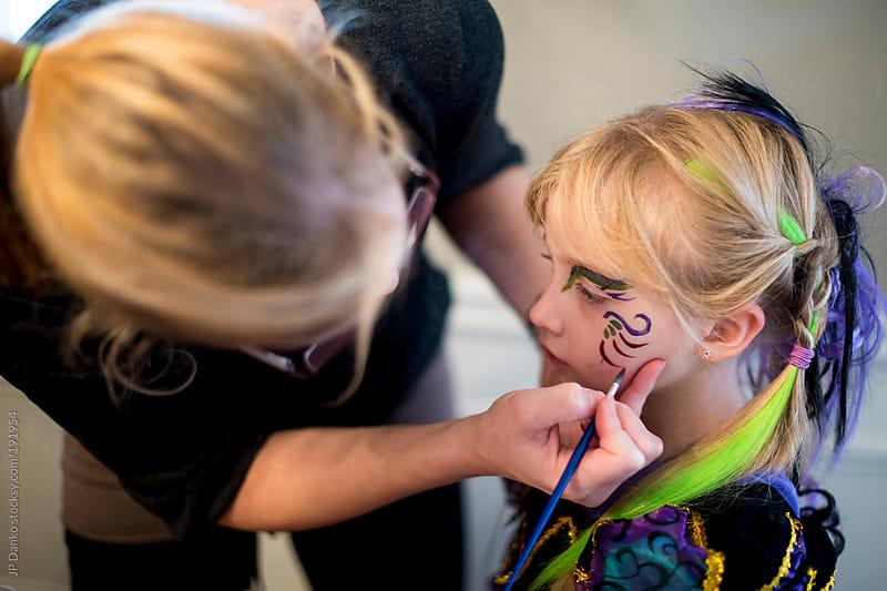 Mom Painting Little Girls Face for Halloween by JP Danko for Stocksy United
