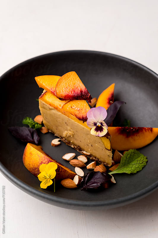 raw vegan peach cheesecake by Gillian Vann for Stocksy United