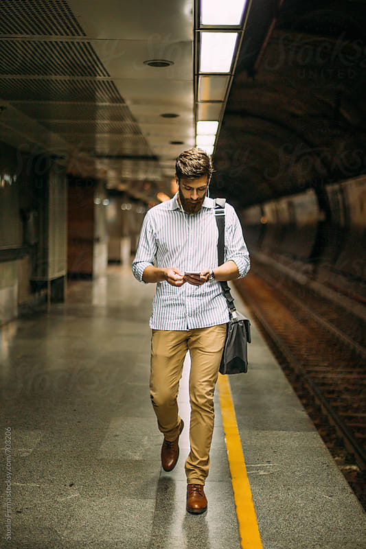 Man waiting for a train. by Studio Firma for Stocksy United