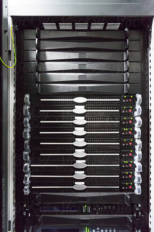 Detail of servers in a rack at a data center  by ACALU Studio for Stocksy United