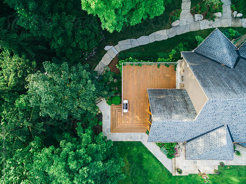 Overhead view of a BBQ grill on a deck by Jen Grantham for Stocksy United