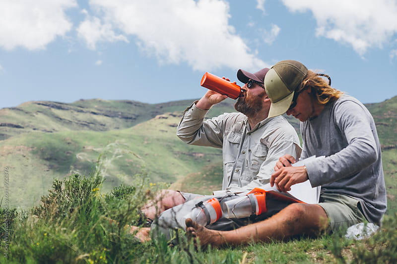 hikers sitting and taking a break whilst out in the mountains by Micky Wiswedel for Stocksy United