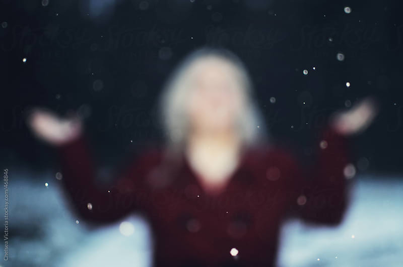 Woman standing in the snow by Chelsea Victoria for Stocksy United