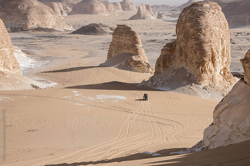 Jeeps travelling in a desert in Egypt. by Mike Marlowe for Stocksy United