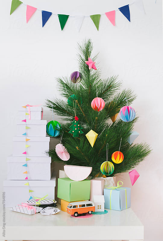 Holiday tree decorated with paper craft by Alita Ong for Stocksy United