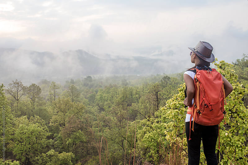 Female hiker looking at view in Pai Canyon, Thailand by Soren Egeberg for Stocksy United