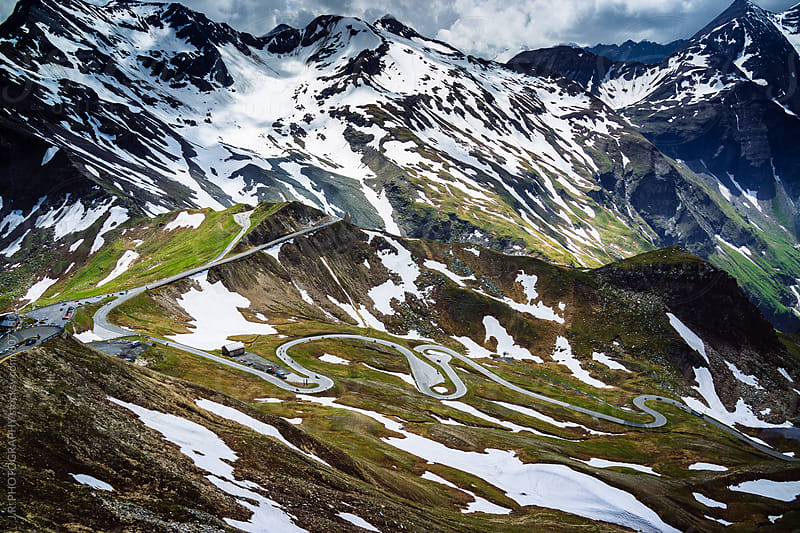 Winding road on alpine landscape by J.R. PHOTOGRAPHY for Stocksy United