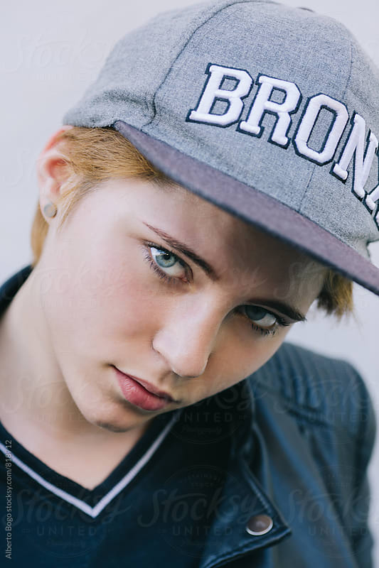 Young woman portrait with cap by Alberto Bogo for Stocksy United