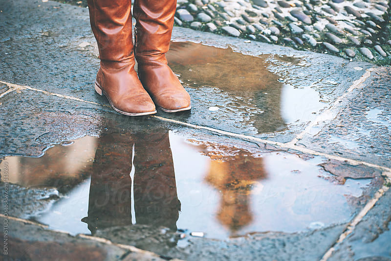 Close up of a reflection in a puddle of the cathedral. by BONNINSTUDIO for Stocksy United