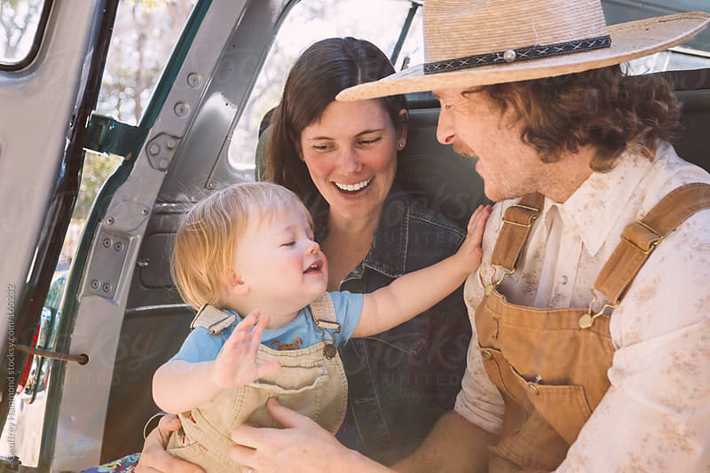 Happy Country Family in Back of Truck by Geoffrey Hammond for Stocksy United