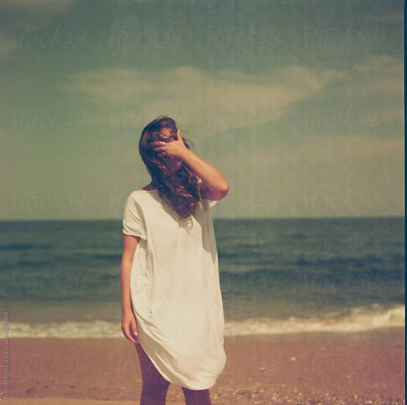 A film portrait of young woman at the beach by Anna Malgina for Stocksy United