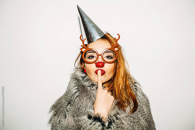 Young woman with deer glasses and nose posing. by Studio Firma for Stocksy United