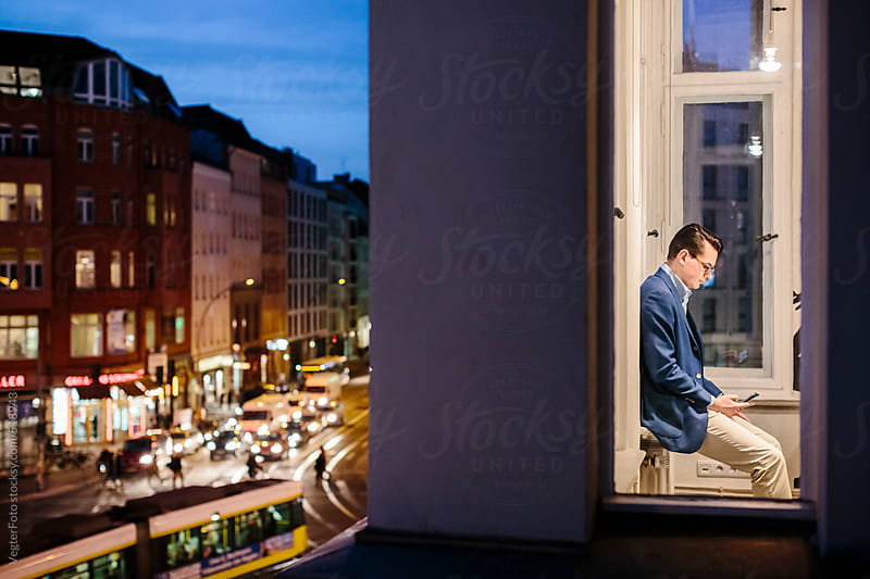 Businessman Working late  by VegterFoto for Stocksy United