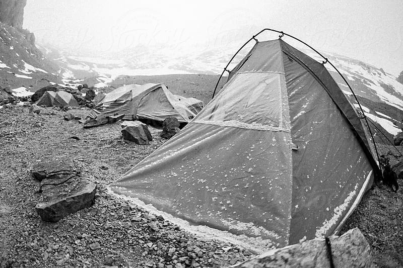 Black and white snowy tent camp by Chris Werner for Stocksy United