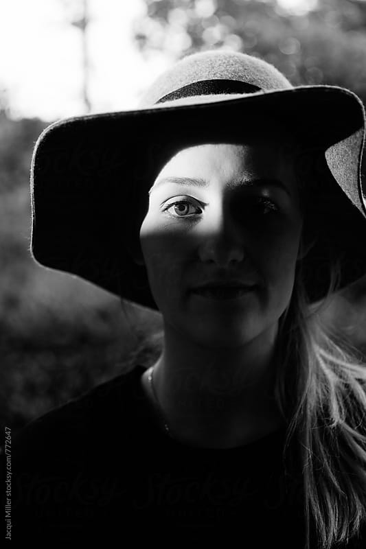 Black and white of young woman wearing a wool hat by Jacqui Miller for Stocksy United