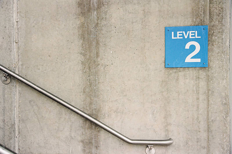 Level 2 in a public parking stairwell by Gabriel (Gabi) Bucataru for Stocksy United