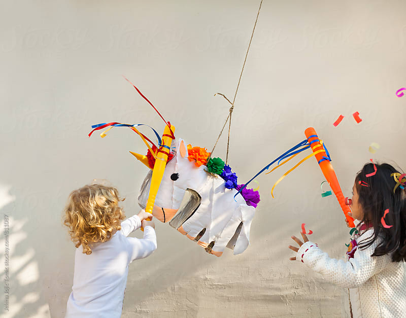 Pinata is going down, fast. by Jelena Jojic Tomic for Stocksy United