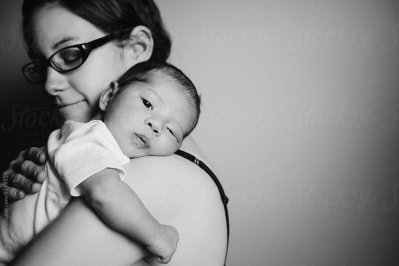 Holding newborn baby by Lauren Naefe for Stocksy United