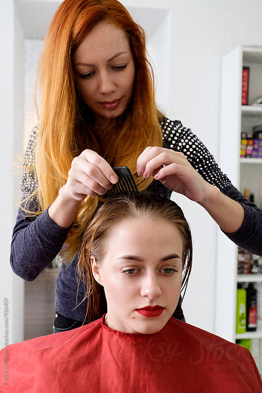 Hairdresser combing client by Danil Nevsky for Stocksy United