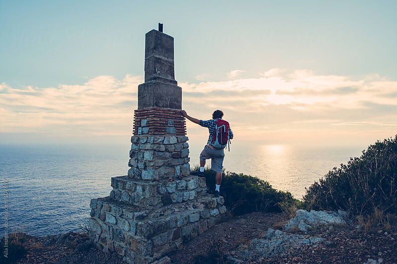 Hiker at Sunrise by Aila Images for Stocksy United
