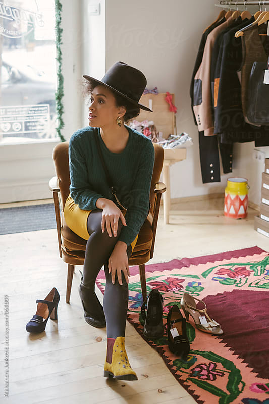 Woman Trying Out Shoes in the Store by Aleksandra Jankovic for Stocksy United