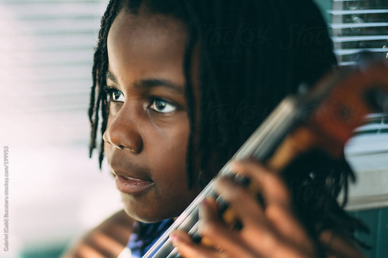 African-American Cute Girl Practicing her Cello by Gabriel (Gabi) Bucataru for Stocksy United